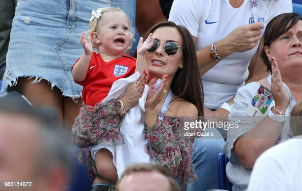 Millie Savage girlfriend of John Stones and their daughter attend the 2018 FIFA World Cup Russia group G match between England and Panama at Nizhniy...