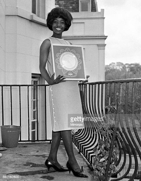 Millie Small Dynamic pop singer of My Boy Lollipop at a reception at Fontana Records where she received her silver disc for a quarter of a million...