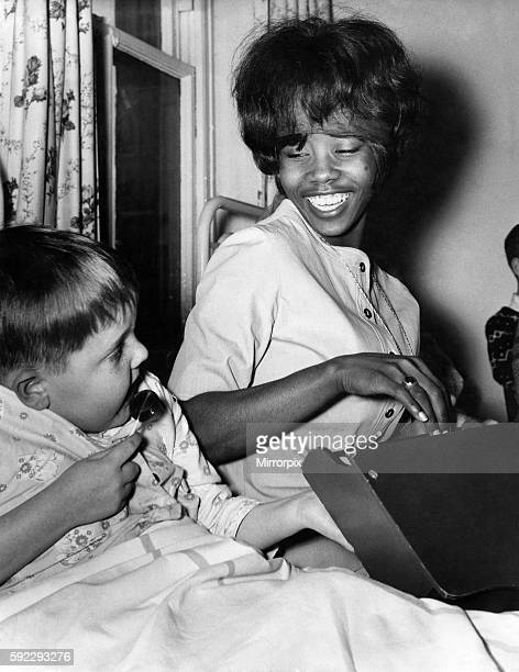 Millie Small sings her hit song My boy lollipop to William Entwhistle during her visit to the childrens ward at Burnley General hospital Mayl 1964...