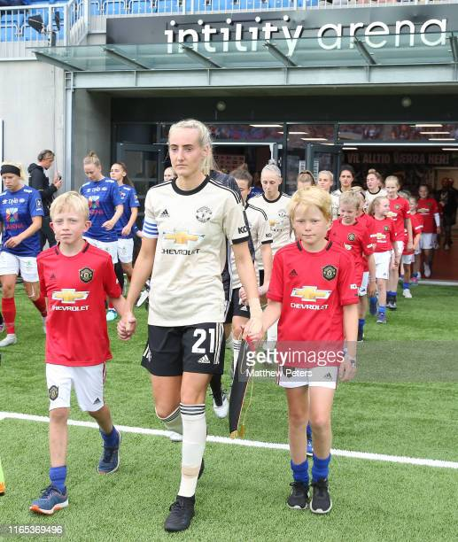 Millie Turner of Manchester United Women leads the team out ahead of the preseason friendly match between Valerenga and Manchester United Women at...