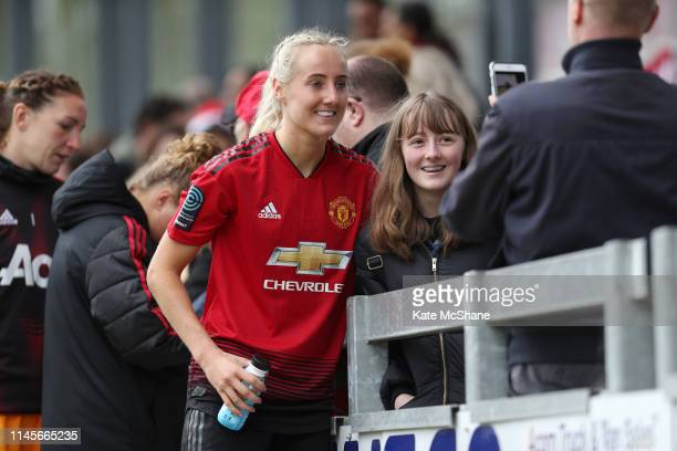 Millie Turner of Manchester United Women poses for a photo with a fan following the FA Women's Championship match between Millwall Lionesses and...