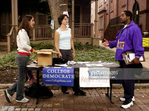 Millie WeinsteinGould Emma Cermak and Gary Hilliard await students to register to vote on the University of Pennsylvanvia campus September 29 2004 in...