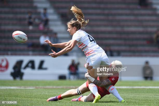 Millie Wood of England passes the ball under pressure by Jennifer Kish of Canada during the HSBC World Rugby Women's Sevens Series 2016/17 Kitakyushu...