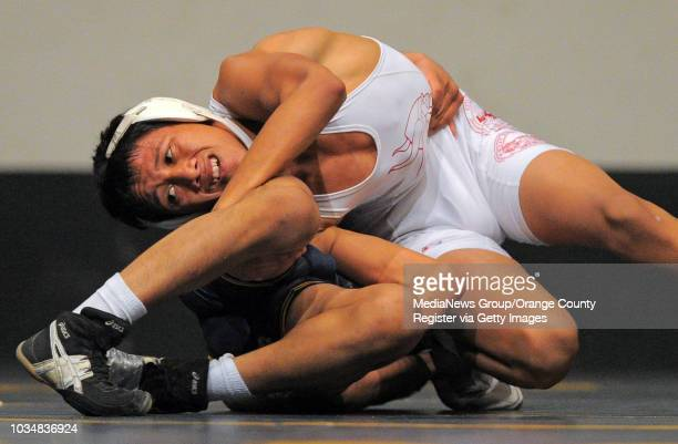 BEACH Millikan vs Downey wrestling Millikan's Angel Castellanos beat Downey's Daniel Martinez in white in the 120 pound match on points