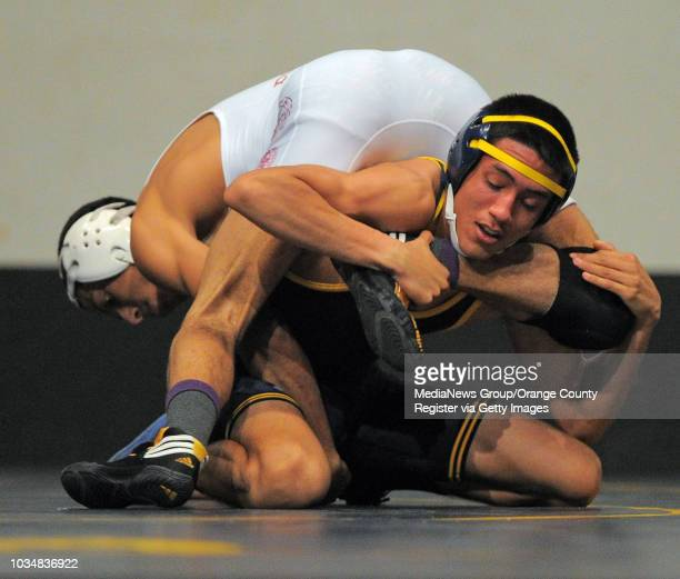 BEACH Millikan vs Downey wrestling Millikan's Kevin Lopez bottom beat Downey's Enrique Carrasco in the 126 pound match on points