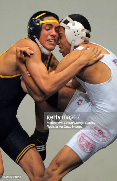 BEACH Millikan vs Downey wrestling Millikan's Kevin Lopez left beat Downey's Enrique Carrasco in the 126 pound match on points