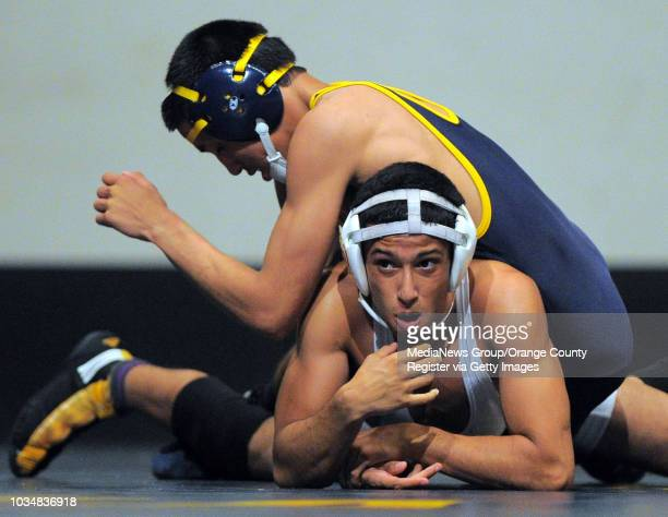 BEACH Millikan vs Downey wrestling Millikan's Kevin Lopez top beat Downey's Enrique Carrasco in the 126 pound match on points