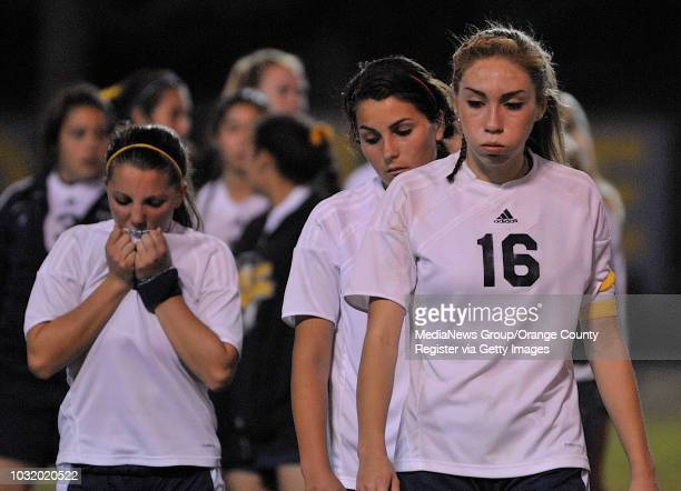 Millikan's Alexandra Palomino , right, Carly Marietti and Katelin Fricke , left, react after losing to Temecula Valley in their CIF-SS Division II...