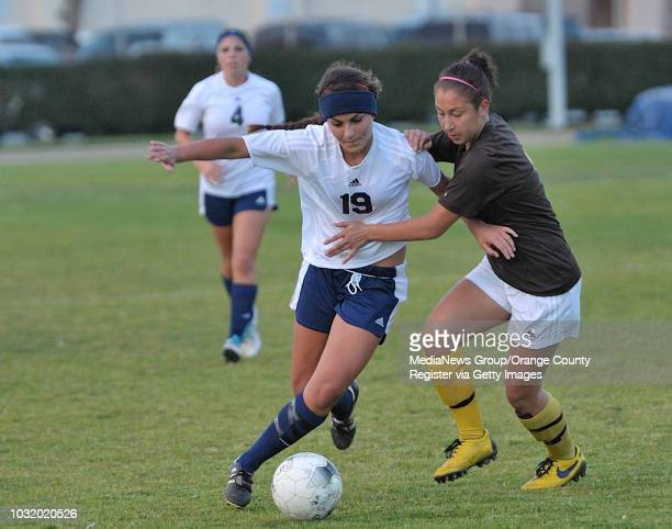 Millikan's Carly Marietti and Temecula Valley's Jacquie Galvez battle for the ball in their CIF-SS Division II playoff game in Long Beach, Calif. On...