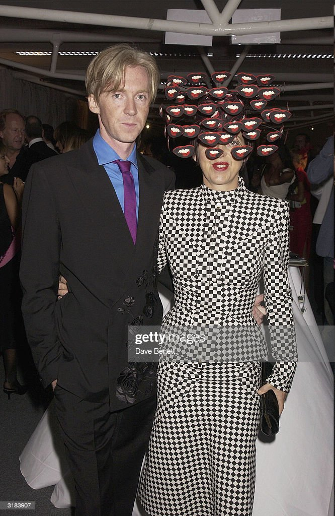 Milliner Philip Treacy and fashion director Isabella Blow attend the Lycra British Fashion Awards, held at the Old Billingsgate Market in London on 25th September 2003.