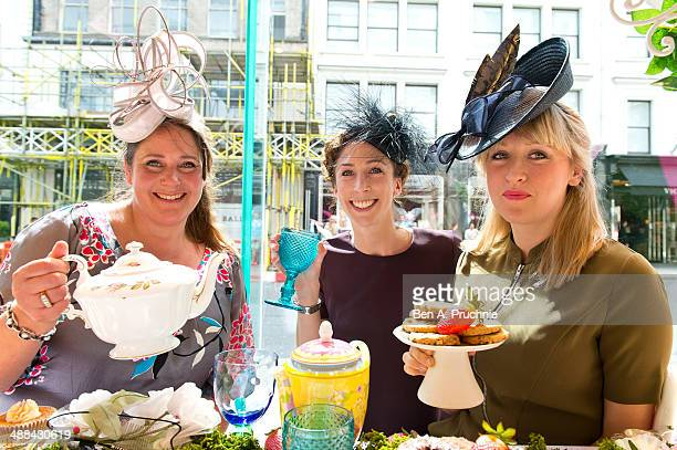 Milliners Vivien Sheriff Rosie Olivia and Jane Taylor pose for photographs ahead of Royal Ascot which takes place from June 17th21st leading London...