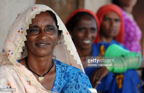 PakistansociallabourpovertyFEATURE by Khurram Shahzad In this picture taken on September 2 Pakistani woman Lalee smiles along with formerly bonded...
