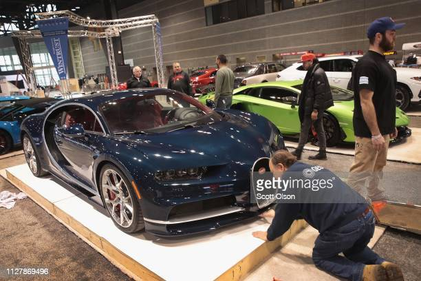 A $3 million Bugatti Chiron is worked into position in the convention hall as workers prepare for the opening of the Chicago Auto Show at McCormick...