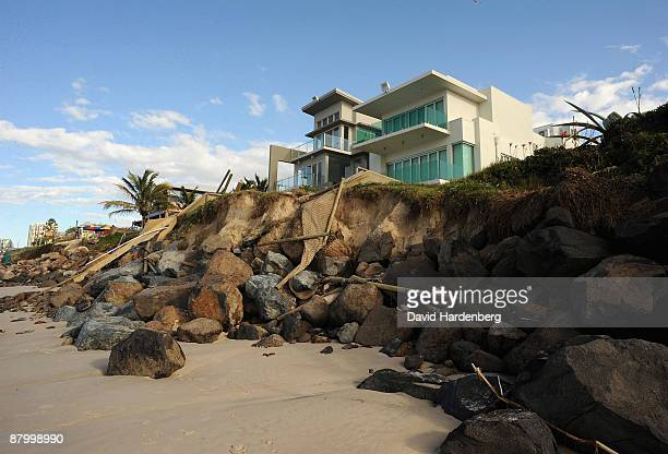 Million dollar beachside homes on Queensland's Palm Beach teeter on the edge of sand dunes following erosion from the recent king tides at Palm Beach...