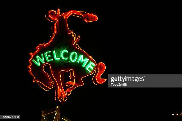 million dollar cowboy bar sign - jackson hole stock pictures, royalty-free photos & images
