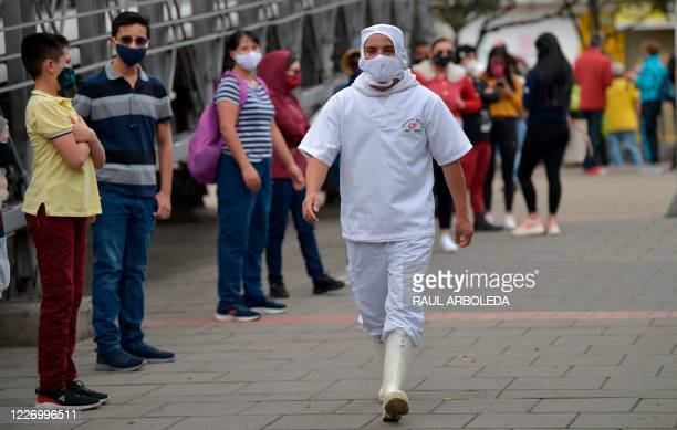 People queue to get tested for COVID19 coronavirus in Bogota on July 13 2020 Some 35 million people returned to strict confinement in Colombia on...