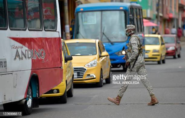 A Colombian marine patrols the streets after a strict quarantine was declared to stop the spread of the COVID19 coronavirus in Bogota on July 13 2020...