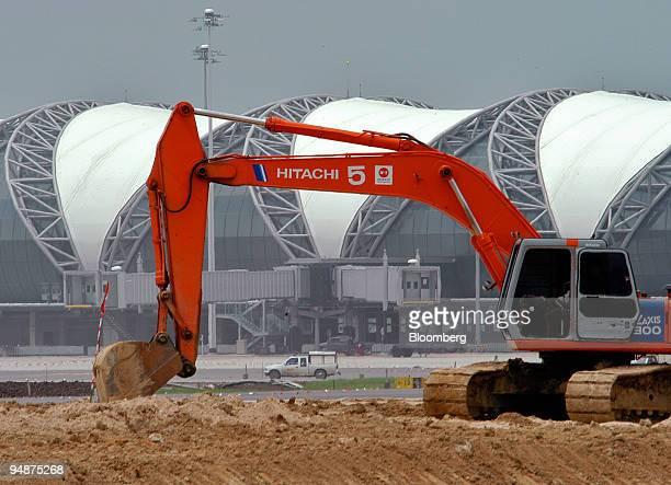 Earthworks are carried out by a Hitachi excavator at Bangkok's new airport Thursday July 28 2005 Construction on the $4 billion Suvarnabhumi...