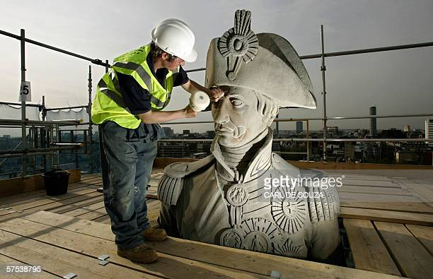 Stone Mason Iain Devine carries out repairs to the face of the statue of Admiral Horatio Nelson at the top of Nelson's Column in Trafalgar Square in...