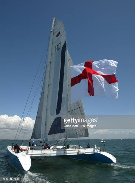 Tracy Edwards' record breaking catamaran Maiden II returns to the Solent flying a 1200 square foot Cross of St George in support of England's World...