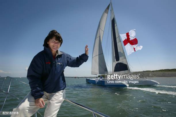 Tracy Edwards watches as her record breaking catamaran Maiden II returns to the Solent flying a 1200 square foot Cross of St George in support of...