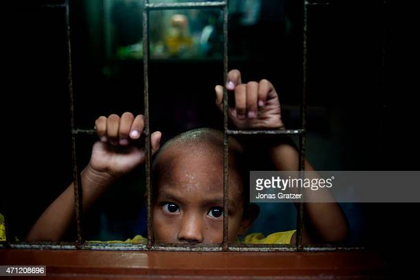 A young child seen through a barred window in Phuket Every year hundreds of thousands of tourists come to Thailand But in the shadow of mass tourism...