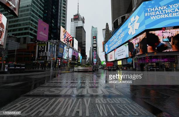 A view of a nearly empty Time Square on April 09 2020 in New York City Another 66 million US workers file for unemployment benefits for the week...