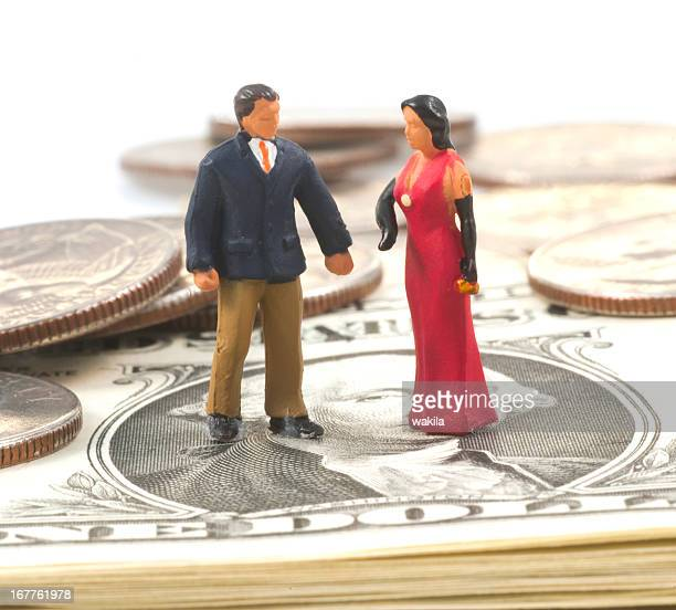 millionaire figurines on dollars - dwarf man stock pictures, royalty-free photos & images