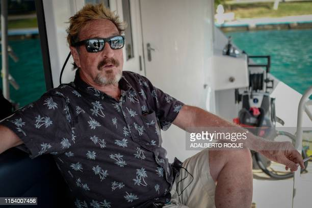 Millionaire John McAfee gestures during an interview with AFP on his yacht anchored at the Marina Hemingway in Havana, on June 26, 2019. - After...