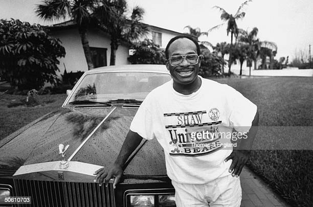 Millionaire lawyer philanthropist Willie Gary wearing Shaw Univ tshirt as he poses in front of his Rolls Royce car in driveway at home after making...