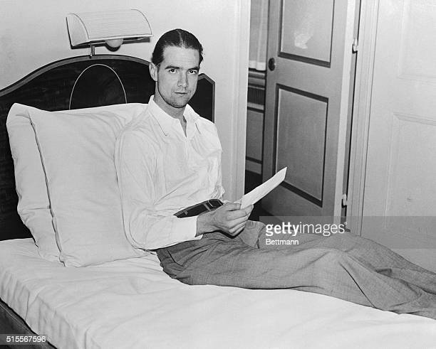 Millionaire movie producer and aviator Howard Hughes resting after breaking coast to coast record