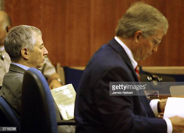 Millionaire murder defendant Robert Durst sits in State District Judge Susan Criss court with his attorney Dick DeGuerin November 10 2003 at the...