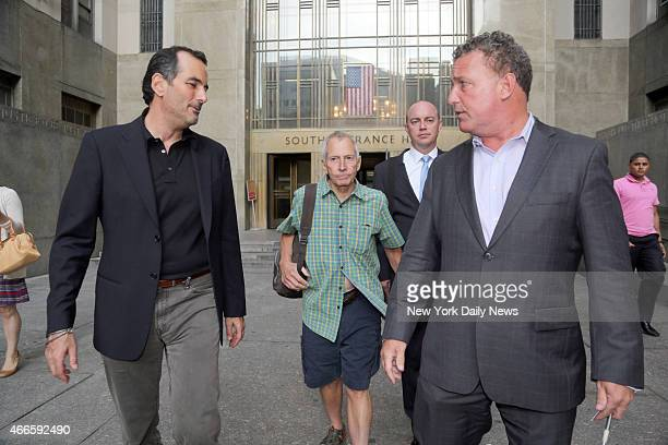 Millionaire Robert Durst leaves Manhattan Criminal Court with his lawyers on Friday August 16 2013 Durst had been arrested for trespassing after...