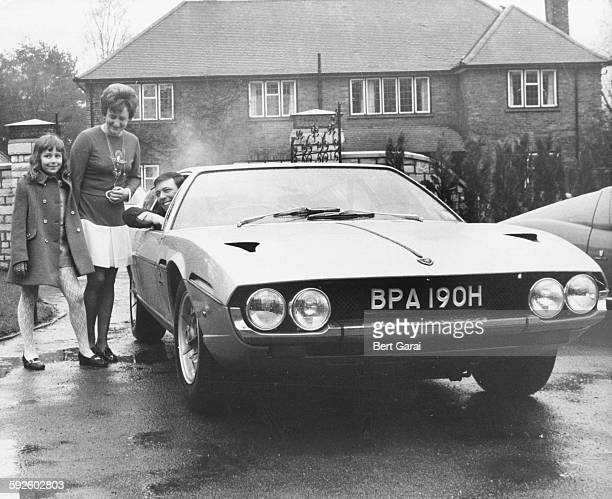 Millionaire song writer Les Reed at the wheel of his new Lamborghini with his wife and daughter Donna April 12th 1970
