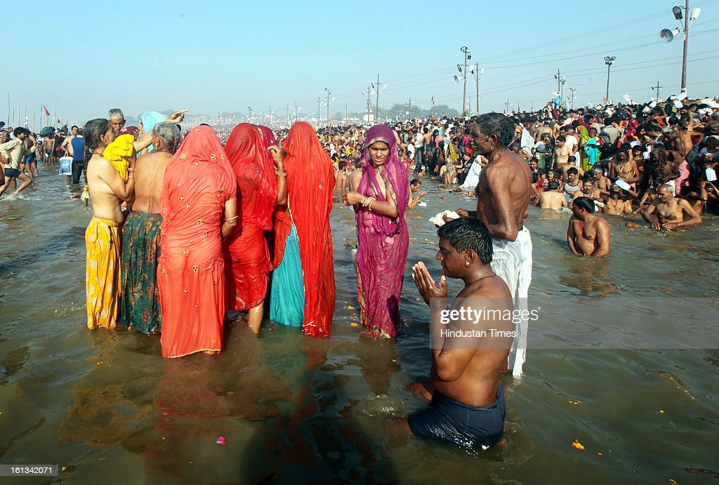 Millions of devotees gathered to take a holy dip at the bank of Sangam confluence of river Ganga, Yamnuna and mythical Saraswati on the occasion of Mauni Amawasya on February 10, 2013 in Allahabad, India. Tens of millions of Hindus gathered Sunday for a holy bath in India's sacred river Ganges on the most auspicious day of the world's largest religious festival.