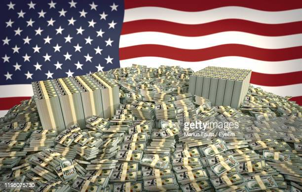 millions of dollars in front of the american flag - money politics stock pictures, royalty-free photos & images