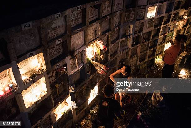 Millions of Filipinos flock to cemeteries around the country to visit departed relatives and loved ones as they mark All Saints Day on November 1...
