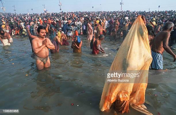 Millions of Hindu pilgrims praying in the Holy Ganges river during the Maha Kumbha Mela festival..