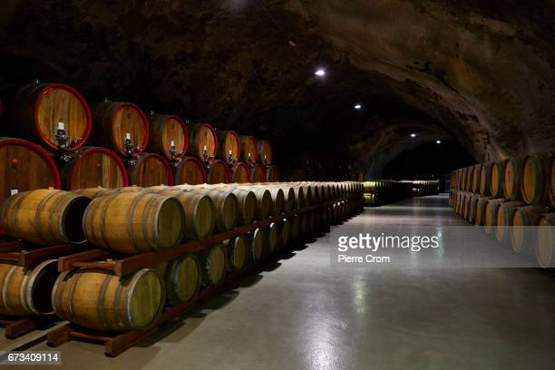 Millions of liters of wine are stored in a wine cellar a former military base in the stateowned winery Plantaze on April 26 2017 in Podgorica...