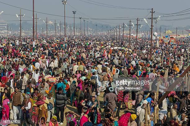 Millions of people gathering at Kumbha Mela ground sitting and sleeping on the ground