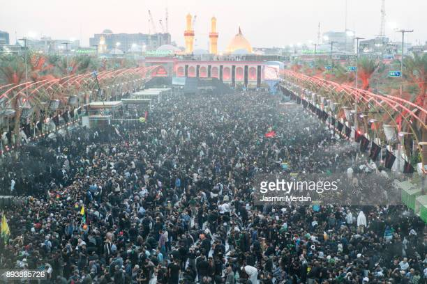 millions of pilgrims in karbala shrine, iraq - arbaeen stock photos and pictures