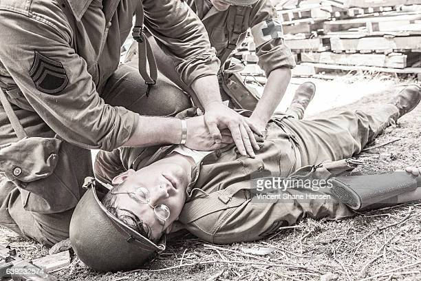 millitary medic - wounded soldier stock photos and pictures