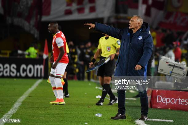 Millonarios coach Miguel Angel Russo or Argentina gives instructions to his players during their Colombian Football League final match against Santa...