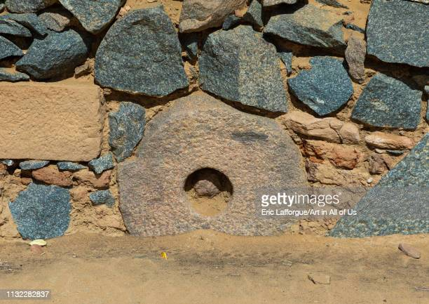 Millstone in a wall of al Ghazali christian monastery Northern State Wadi Abu Dom Sudan on December 27 2018 in Wadi Abu Dom Sudan