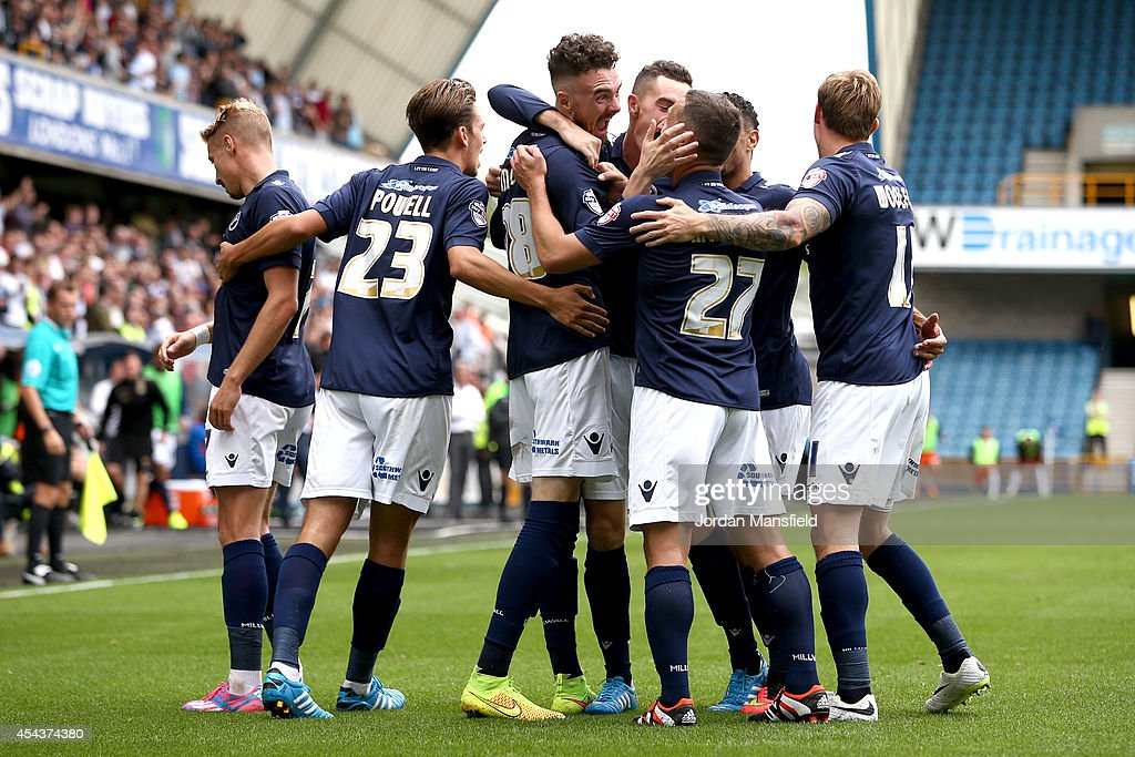 Millwall celebrate with Scott Malone after he scores to make it 2-0 during the Sky Bet Championship match between Millwall and Blackpool at The Den on August 30, 2014 in London, England.