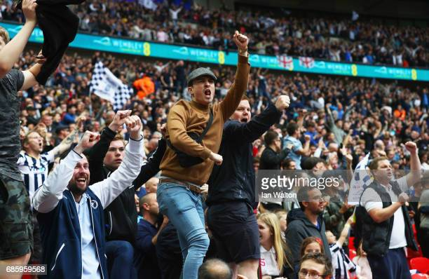 Millwall fans celebrate as Steve Morison of Millwall scores their first goal during the Sky Bet League One Playoff Final between Bradford City and...