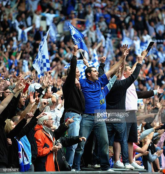 Millwall fans celebrates promotion in the CocaCola League One Playoff Final between Millwall and Swindon Town at Wembley Stadium on May 29 2010 in...