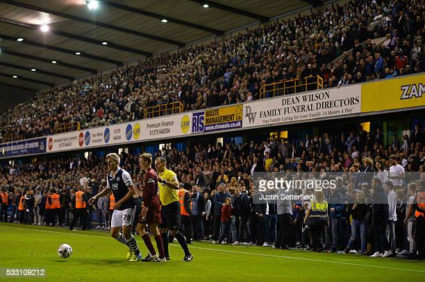 Millwall fans gather around the pitch during the Sky Bet League One Play Off Second Leg between Millwall and Bradford City at The Den on May 20 2016...