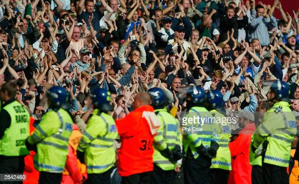 Millwall fans held back by police after the Nationwide first division match between West Ham and Millwall at Upton Park on September 28 2003 in London