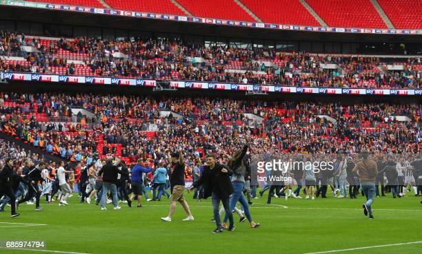 Millwall fans invade the pitch in celebration after the Sky Bet League One Playoff Final between Bradford City and Millwall at Wembley Stadium on May...